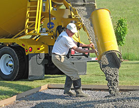 Construction worker pouring cement