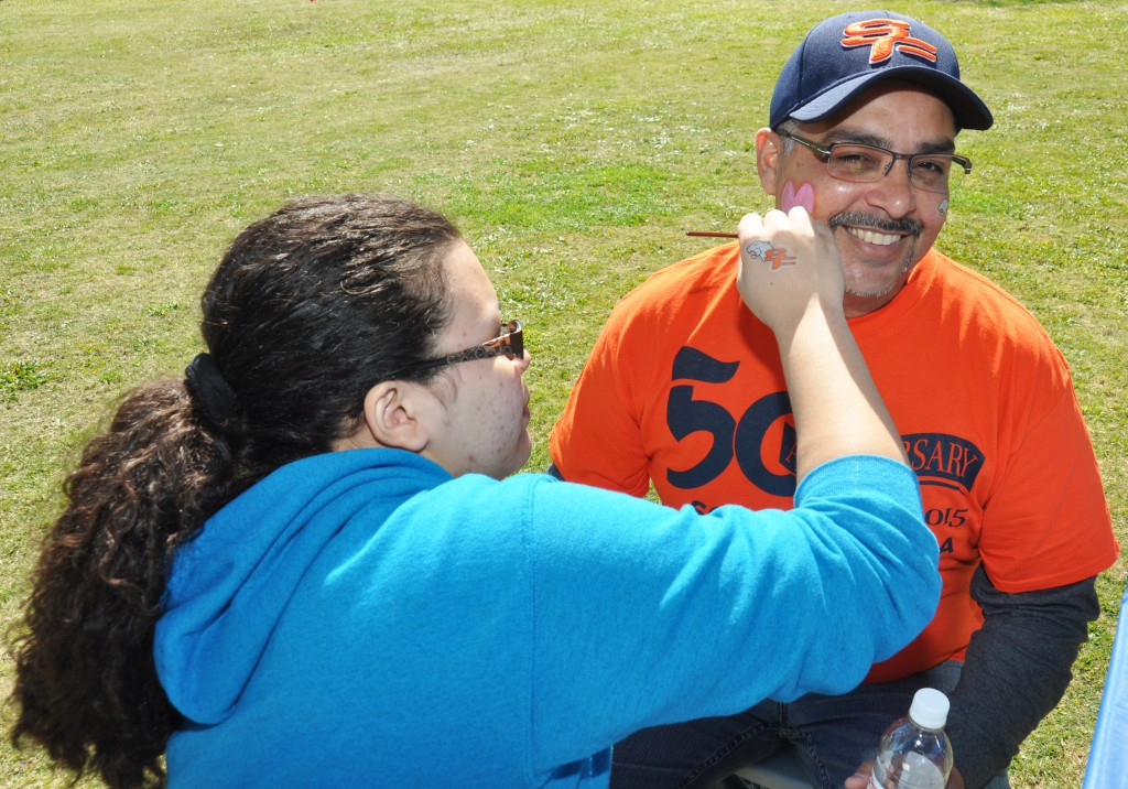 Eddie Cuencas, SFSC's Panther Youth Partners coordinator, celebrated Valentine's Day at the Kick-Off Celebration by getting a heart painted on his face from an SFSC art student.