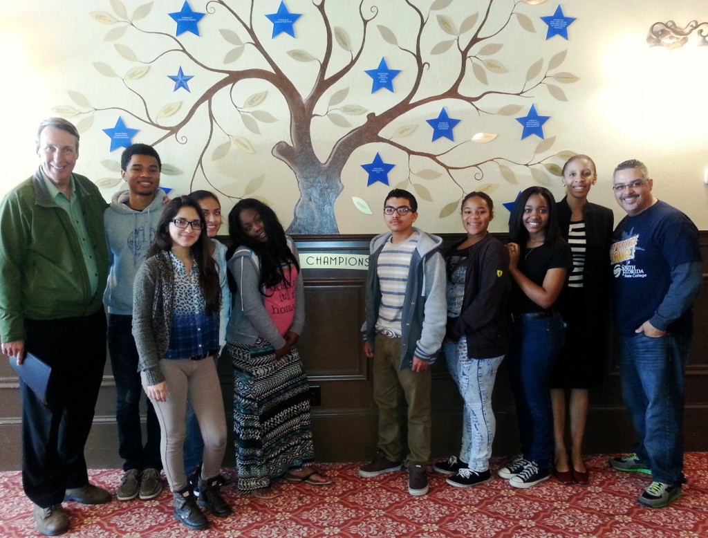 Pictured (left to right): Kevin J. Roberts, chief executive officer for Champion for Children; Daniel Contreras; Marcela Badillo; Selena Badillo;  Edeline Bebe; Honorio Marquez; Nyara Whitlock; Tikira Battle; Aisha Alayande, director for Drug Free Highlands; and Eddie Cuencas, coordinator for SFSC's Panther Youth Partners program.