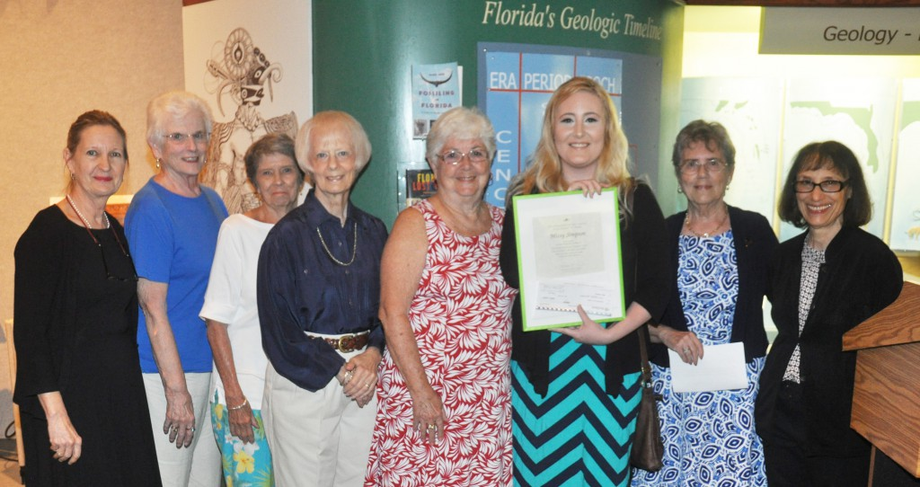 Missy Simpson, third from right, accepts a $300 check and plaque for winning the Tanglewood Art League Scholarship during the annual SFSC Student Art Show Awards ceremony April 16. Pictured with her are, from left: Cathy Futral, SFSC professor of art; Tanglewood Art League members Sandra Sephans, Judy Leblanc, Judith Eckstein, and Peggy Scefcyk; Missy Simpson; Norma Evans, president of the Tanglewood Art League; and Mollie Doctrow, SFSC MOFAC curator.