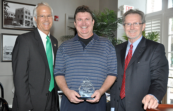 "Dr. Tom Leitzel (left) and Don Appelquist (right) present the Carol Emery Endowed Teaching Award to James ""J.J."" Moye."
