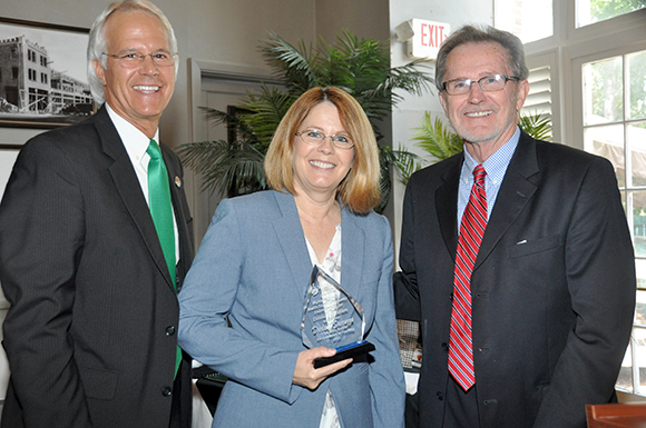 Becky Sroda, dean, Health Sciences, accepts the Endowed Teaching Chair in Nursing on behalf of nursing professor Darlene Saccuzzo. The award was presented by Dr. Tom Leitzel (left) and Don Appelquist.