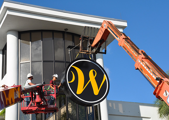 Sign Crew Places New Signage