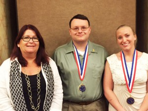 From left: Kimberly Hemler, Christian Reitnauer, and Eric Roberts after the All-Florida Academic Team awards ceremony.