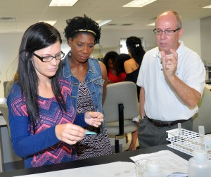 Dr. James Hawker with students during class.