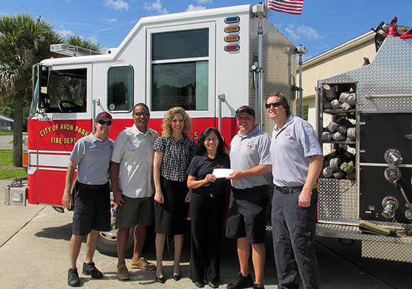 Photo:  (pictured from left): Firefighters Clint Culverhouse and Warren West, SFSC Executive Director of Institutional Advancement Jamie Bateman, TSIC Program Coordinator Irene Castanon, and firefighters Anthony Gaines and Mike Turek