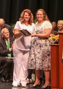 Nursing instructor Laurie Simmons (right) accepts Golden D.U.C.K. award