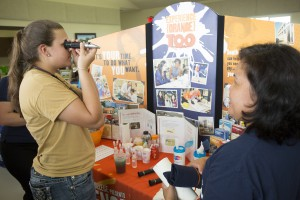 A student at the Youth Field Day measures the sugar content of juice using a refractometer.