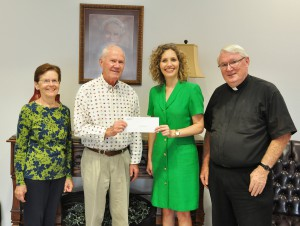 From left: Marilyn Conroy, Jim Conroy, Jamie Bateman, and Rev. Nicholas McLaughlin at Our Lady of Grace Catholic Church.