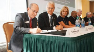 SFSC president Dr. Thomas C. Leitzel (second from left) at a ceremony at the University of South Florida launching FUSE.