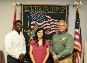 From left, Adson Delhomme, Jazmin Gonzalez, and sheriff Arnold Lanier at the Hardee County Sheriff's Office.