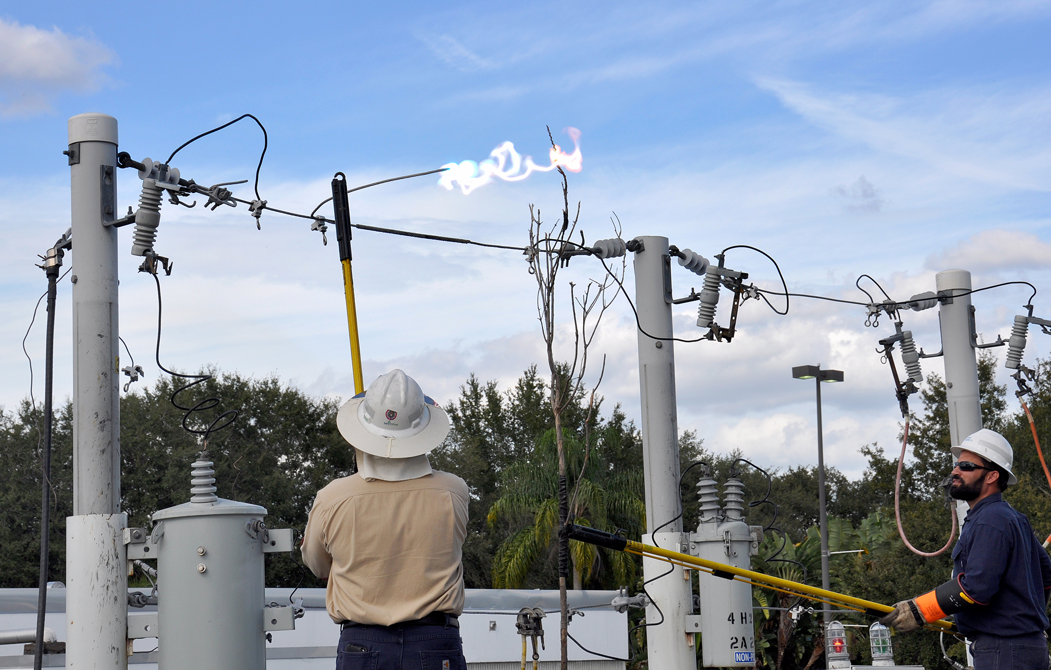 A Duke Energy instructor shows how electrical lines spark fires in this safety course at the Great Florida Fire School.