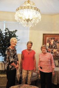 Under the chandelier or Room 208 of the Hotel Jacaranda. From left, Nancy Palmer, Barb Hall, and Joan Hartt.