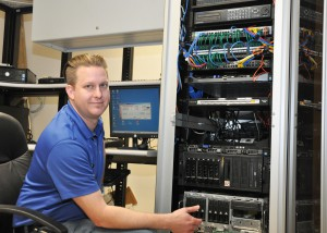 Protasio at work in front of the server rack at the city of Sebring.