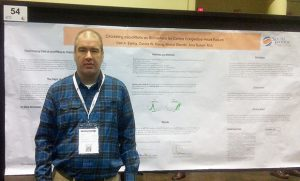 Carl Ewing with research project results poster at the conference