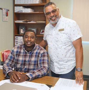 Antonio James and Eddie Cuencas in Antonio's office.