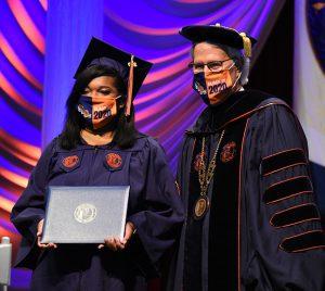 Graduate with President Leitzel