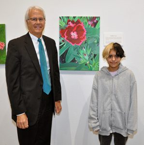 """Dr. Thomas Leitzel (left) and Caitlin Cruz with """"Red Flowers"""""""