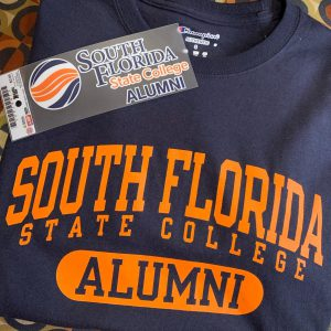 An SFSC alumni bumper sticker and t-shirt.