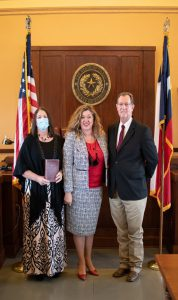 Photo of three including Rebecca Fleck, Audrey Young, Trinity County Judge Doug Page