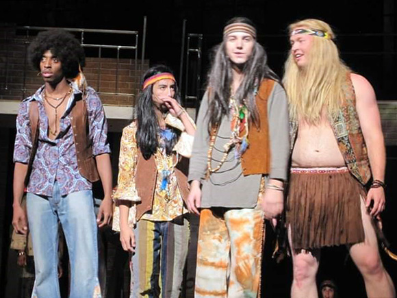 """Photo of Derrick Roper performing in the musical """"Hair"""""""