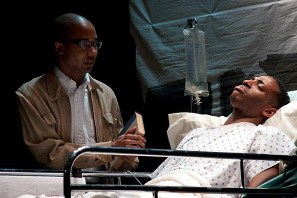 """Photo of Derrick Roper in the play, """"Before It Hits Home"""""""