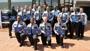 Group photo of the 19 graduates of the Basic Corrections Class 21-104