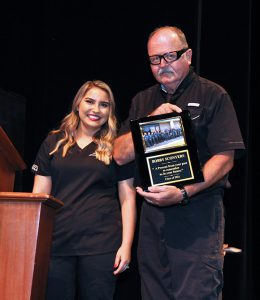 Deborah Figueroa presents a plaque to Bob Sconyers