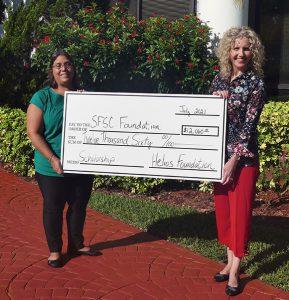 Tina Stetson and Jamie Bateman with big check