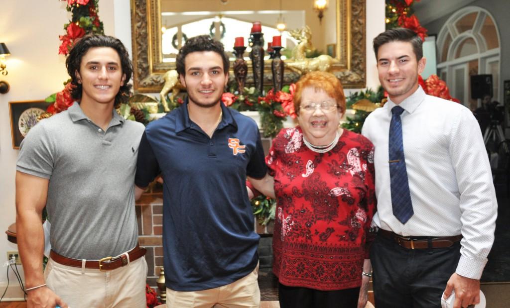 Anne Bond and three SFSC baseball players